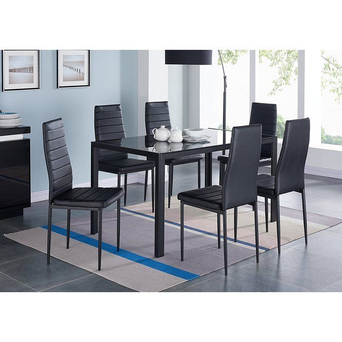The Modern Glass 7 Piece Dining Table Set Includes A Glass Topped Table And Six Comfortable Glass Dining Table Set Glass Dining Table Modern Glass Dining Table