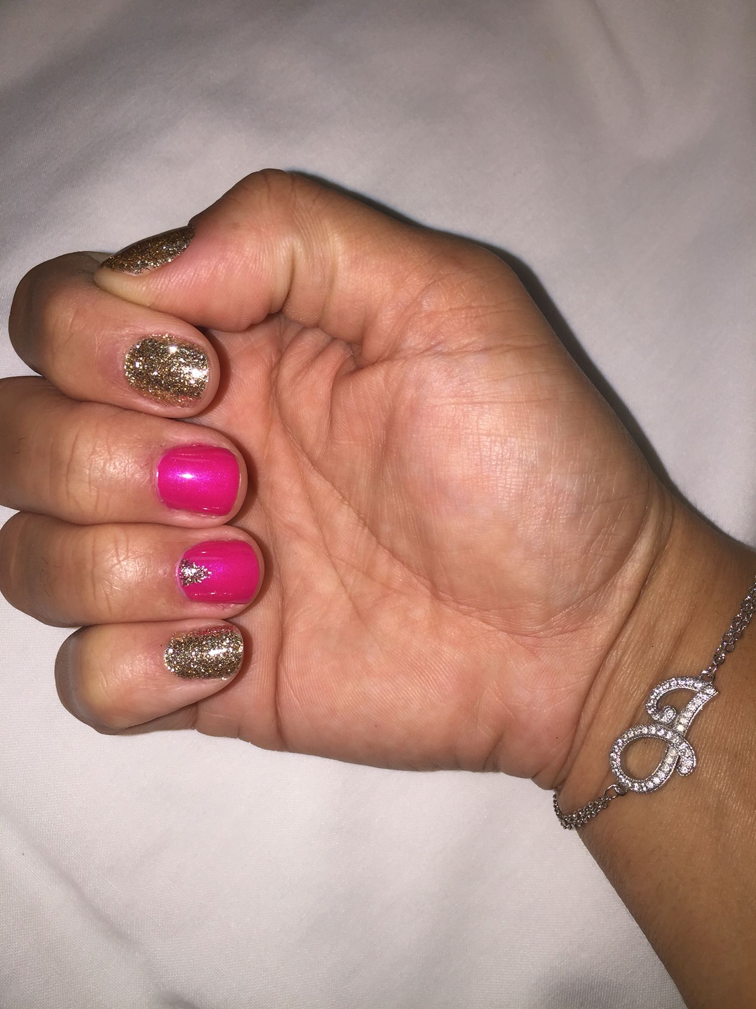 Gelish mani by me! Gold glitter and pink gel polish
