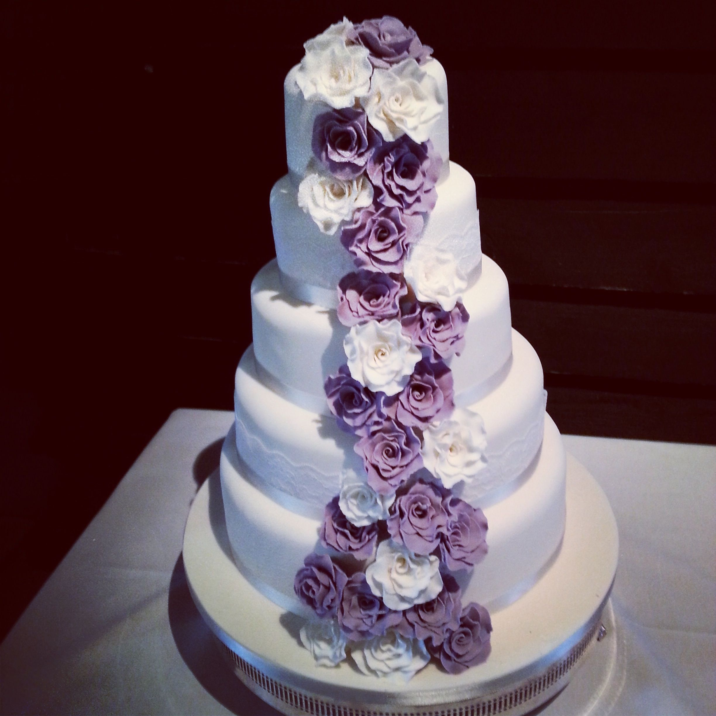 Classic 5 tier cake with a cascade of sugar flowers