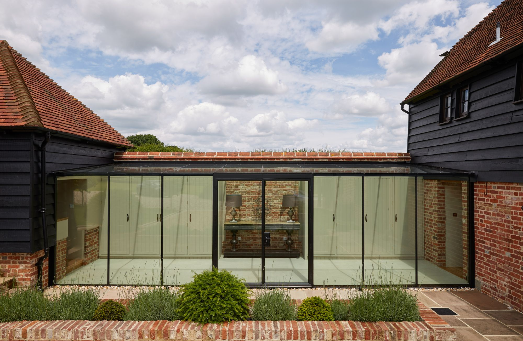 Frameless Structurally Glazed Walkway Link Between