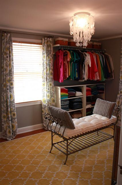 Extra bedroom turned dressing room. I do t love the excecution of this as much as I appreciate the idea.