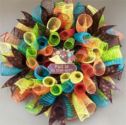 "20"", Sm 'Fall is in the Air' Hedgehog Spiral Mesh Wreath in Orange, Lime, Brown, Teal & Yellow and Brown Cheetah Ribbon; $40 Made by Red-y Made Wreaths. Like & Follow us on Facebook https://www.facebook.com/pages/Red-y-Made-Wreaths/193750437415618 or Visit us at http://www.redymadewreaths.com/"