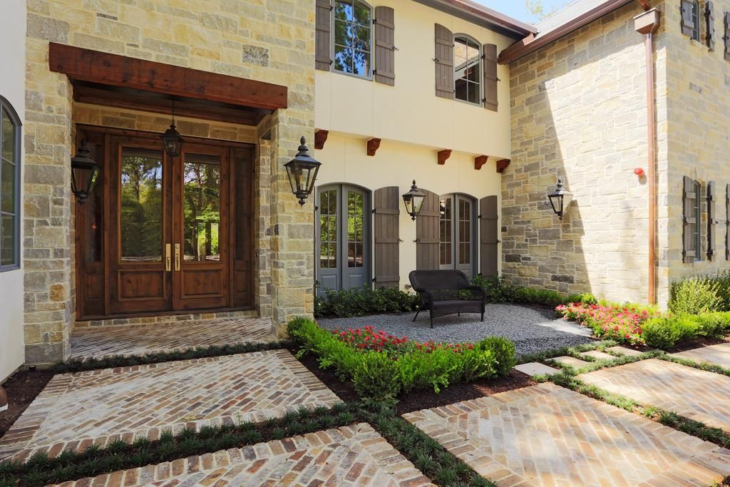 Geometrically designed brick walkways accented with low for Outdoor foyer ideas