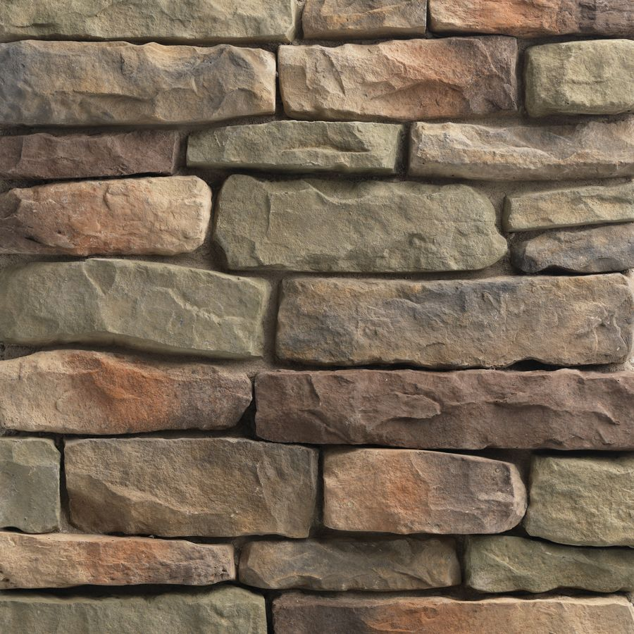 stone siding to complement red brick and patio deck. Shop