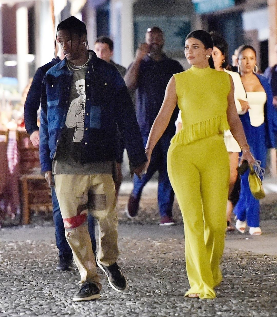 kyliejenner and travisscott hold hands while enjoying a