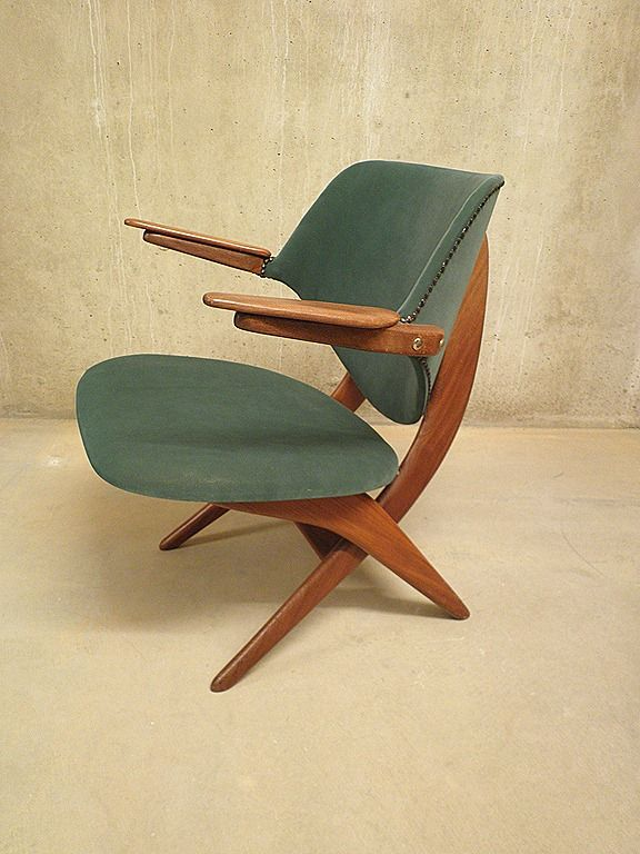 These look a little like first class airline seats from the  Louis van Teeffelen Teak Pelican Armchair for WeBe 60 s