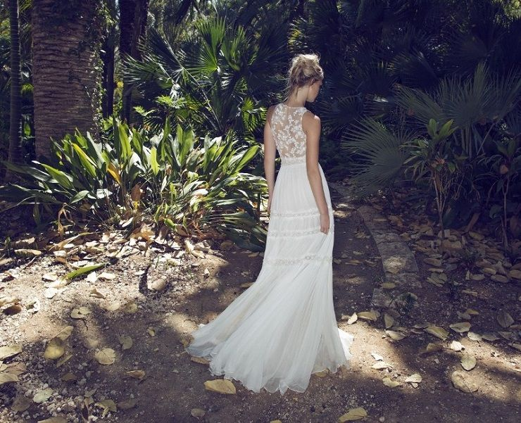 floral applique lace with a deep neckline and a sequin wedding dress | itakeyou.co.uk #wedding #weddingdresses #weddingdress #weddinggown #limorrosen