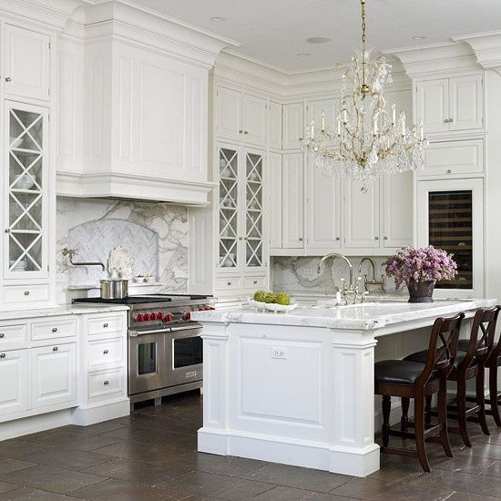Elegant, Glamorous Kitchen With White Cabinetry And X-front Glass Doors. Grand Kitchen Island
