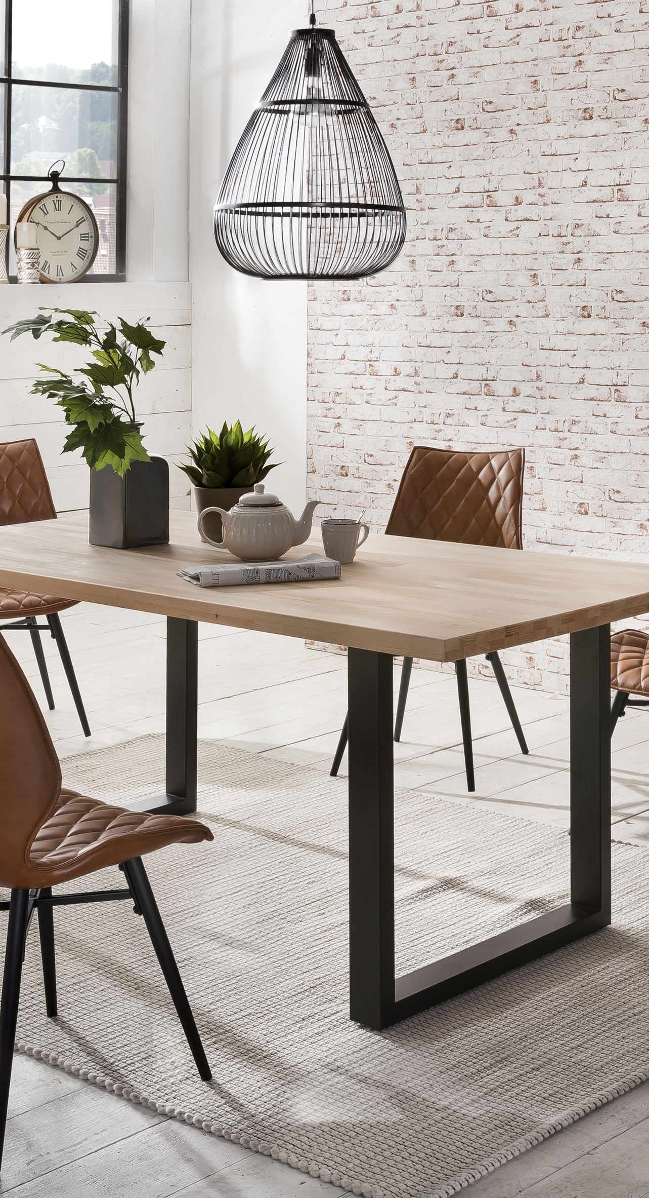 Natural wood dining table with industrial black legs