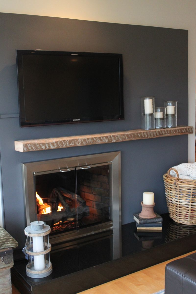 off-center fireplace | We wanted to make the shiny black granite ...