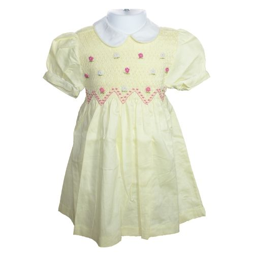 """Vikki (Lemon) - Traditional smocked dress with embroidery overlay.  Styled with short """"cuff"""" sleeves and """"Peter Pan"""" collar. Button fastening at the back, with matching fabric """"ribbons"""" to tie a bow.  Fabric piping to collar and cuffs to compliment embroidery. Available in sizes 5-6 and 7-8 years."""