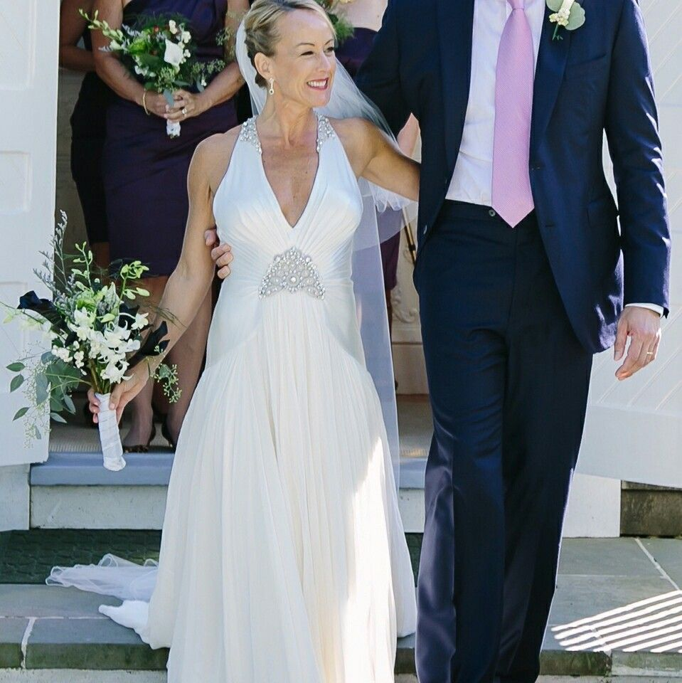 This halter style wedding gown has lightly beaded sections the a