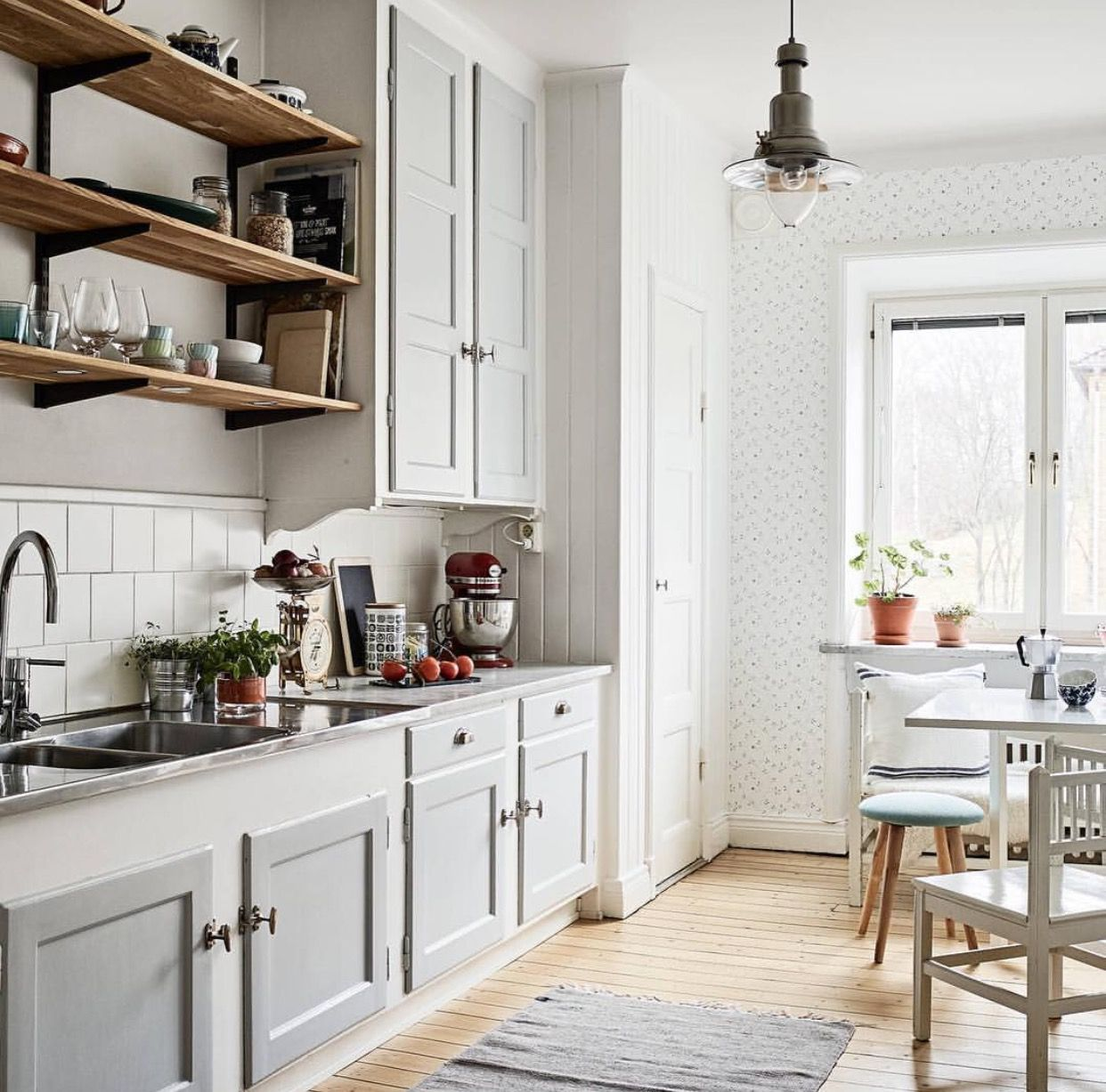 Gray kitchen cabinets open shelving light wood floors the