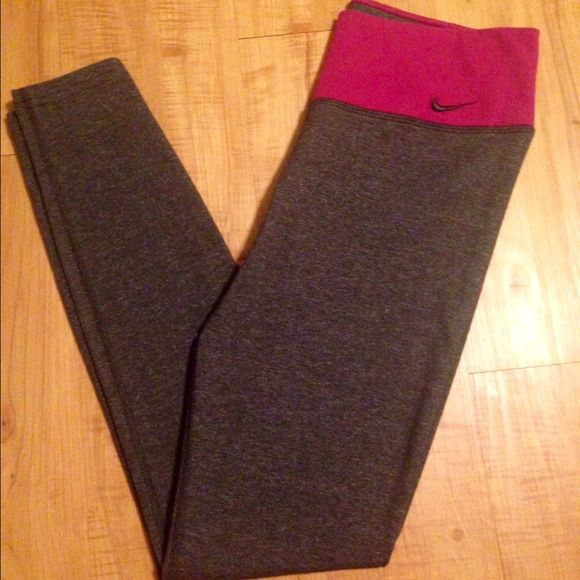 Nike Legendary Tight (Women's Training Tights) Super comfortable dark gray leggings! Dry fit with a thick waist band offering full support, aka they don't slide down! Never been worn! I'm not a small and I forgot to return them. Ankle length. The waist band is a Magenta color. Nike Pants Leggings