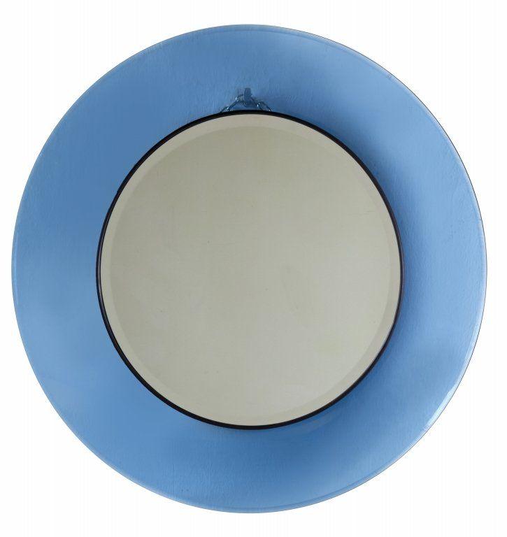 """MAX INGRAND Uno specchio da parete """"1669"""" per FONTANA ARTE, 1967. Cristallo colorato curvato molato, cristallo specchiato, ottone. Diametro cm 75."""
