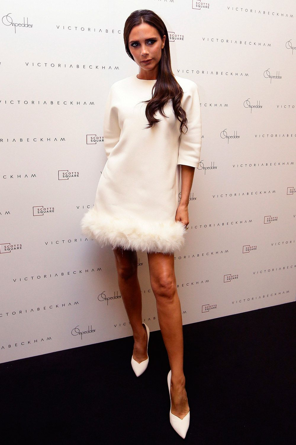 Ever since we spotted VB rocking a white dress complete with an adorable  faux-fur