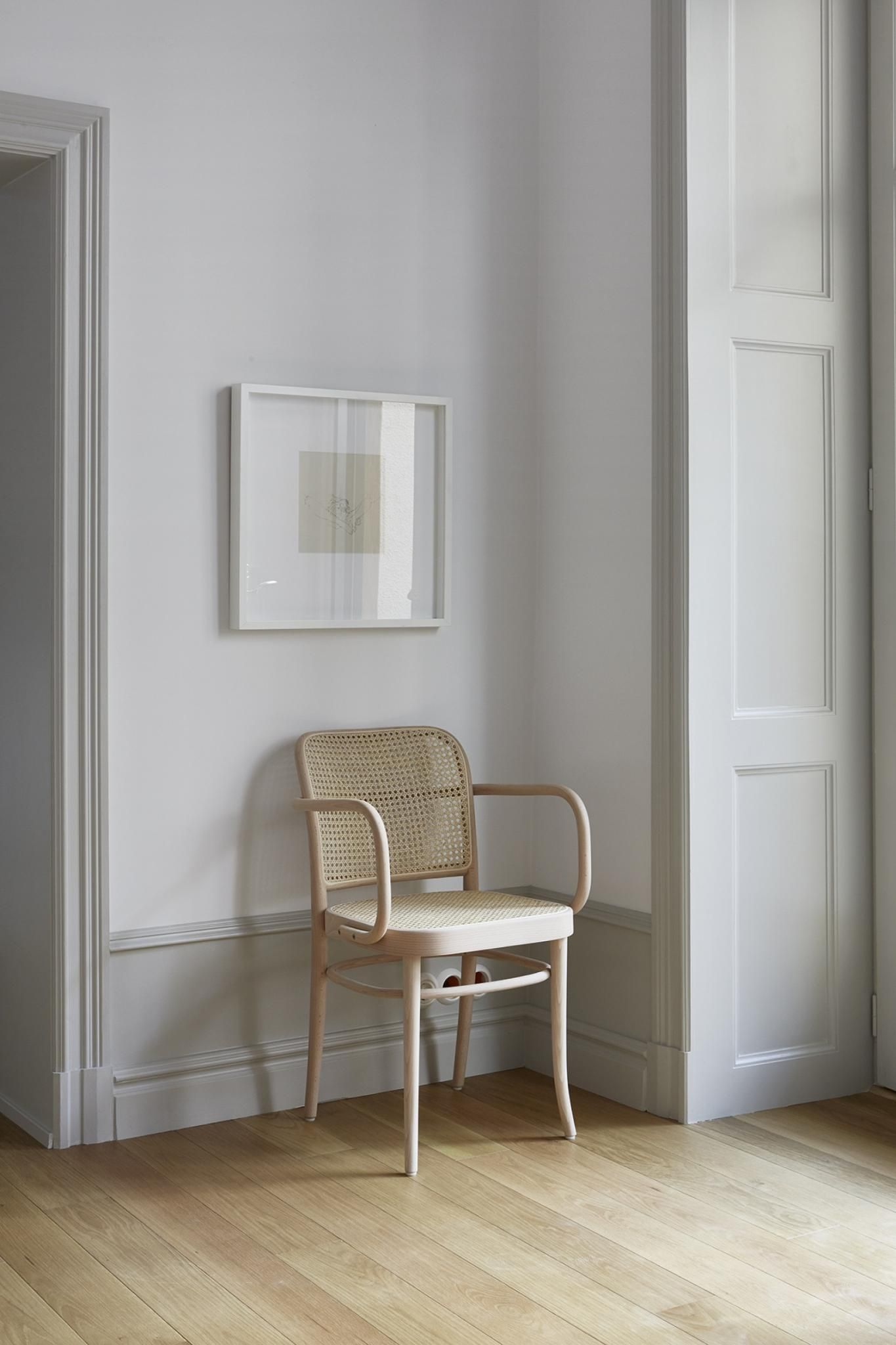 Serene stockholm apartment with bentwood chair and framed art 23 tranquil interiors with light grey and white and be inspired