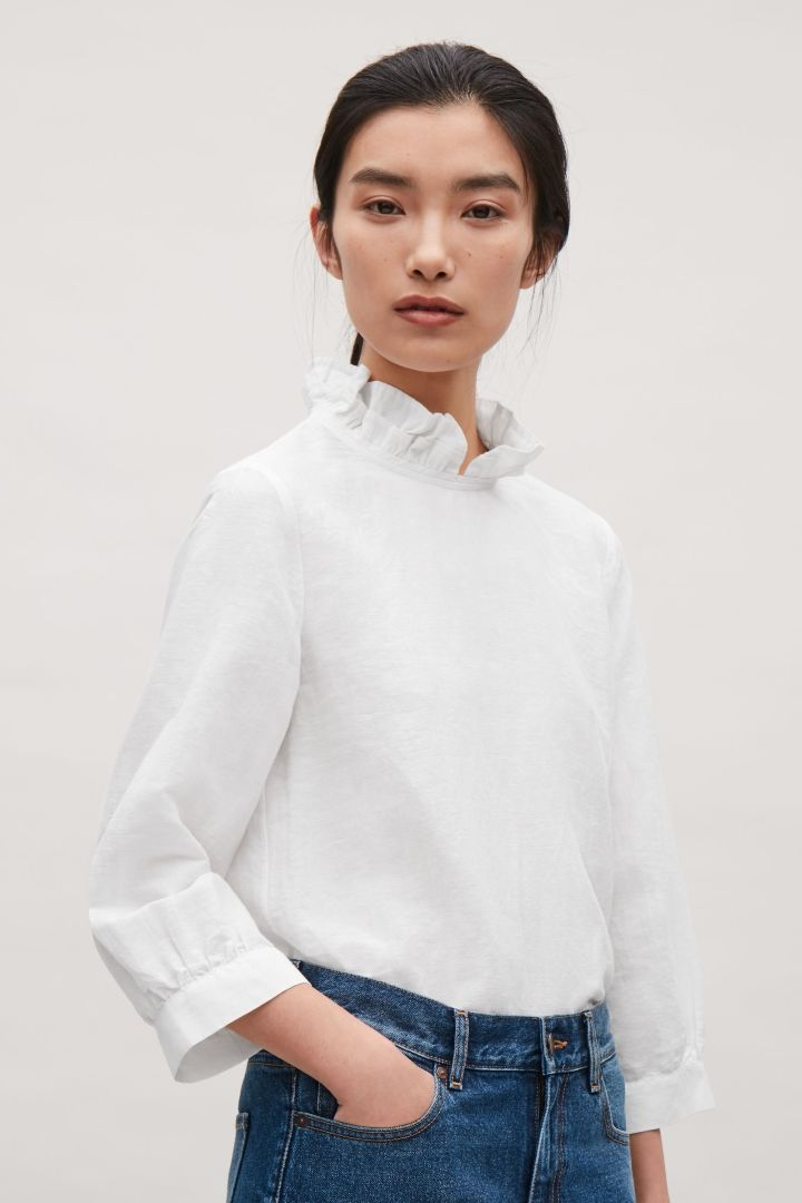 f74eeeb4c4e1fc COS image 3 of Frill-neck blouse in White | 'COS Essentials wishlist ...