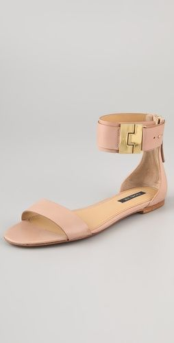 i love the nude color and gold buckle on these rachel zoe sandals. elegant, simple, chic, and different.