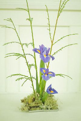Ikebana is based on harmony of simple linear construction and appreciation of the subtle beauty of flowers and natural materials.