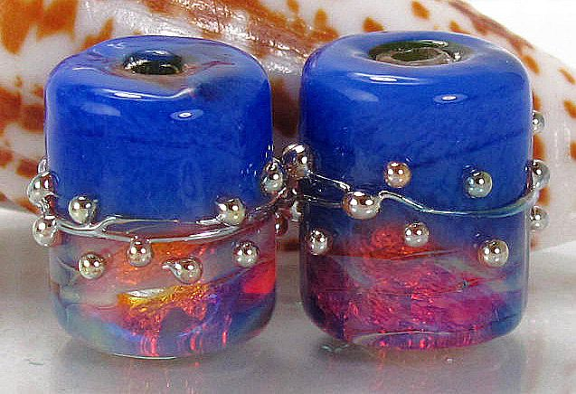$17.50 Ming Blue Barrels  A large stunning earring pair with a beautiful bright hot pink and copper opalescence. Accented with a beautiful ming blue. Wrapped in a silver stringer and silver dots for extra polish! MADE TO ORDER. PLEASE SEE MADE TO ORDER DETAILS BELOW.    Two large barrels 15 x 13 with a hole of 2 mm approx
