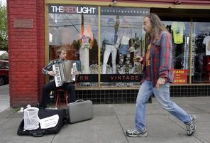 Portland's Hawthorne district is home to street buskers and funky vintage clothing stores.