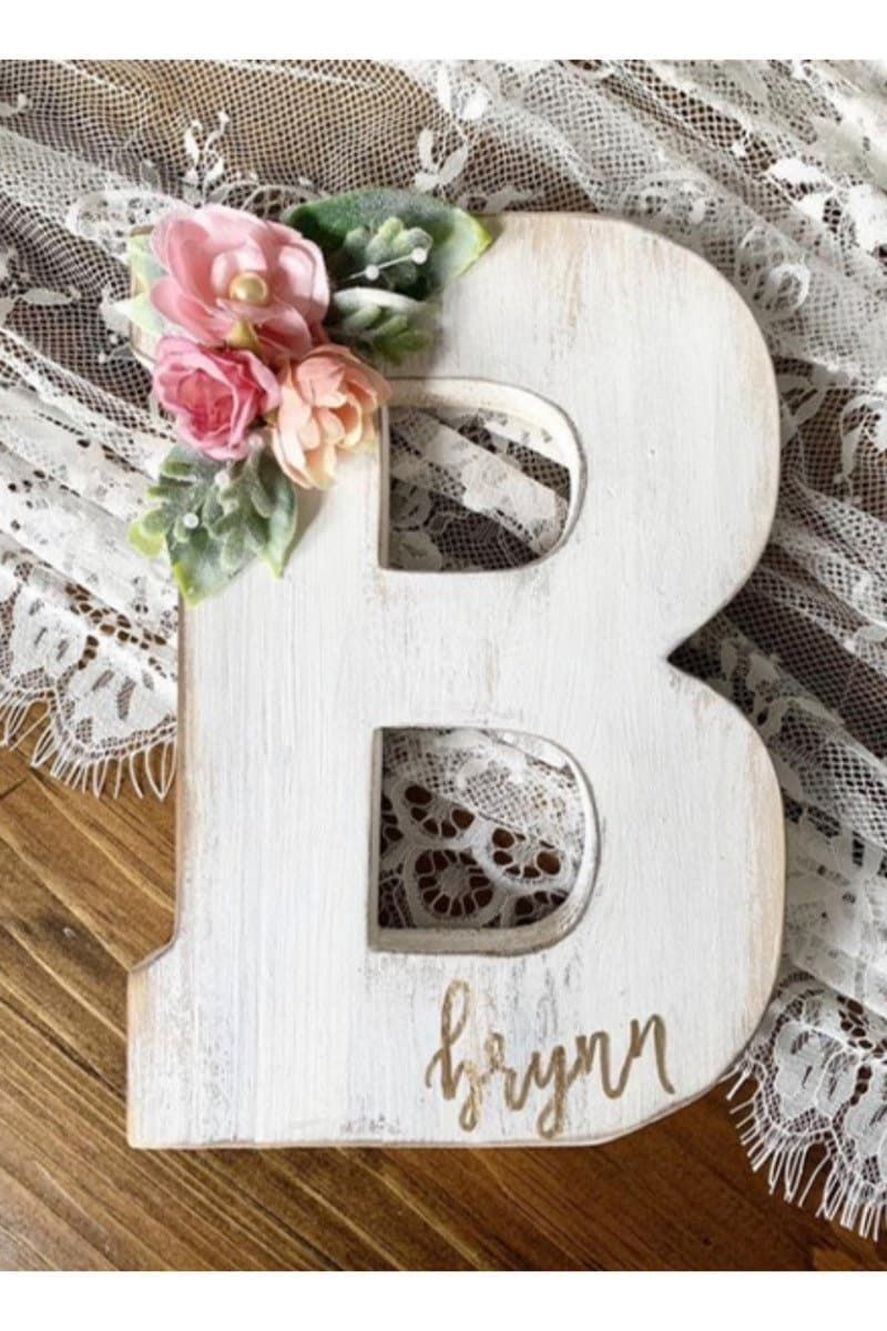 """""""Nursery letters, wooden letters, nursery decor, floral wood letter, baby monogram, wall hanging letters Perfect your babes nursery even further with this whitewash/distressed 7.75 inch wooden letters. Personalize with her name written in lower-case, gold, freehand lettering by myself. ‼️Letters A through Z available!‼️ Please choose below whether you'd like to have it personalized with her name please! Comes with hole on the back for easy hanging. (Swipe for picture) 🌸 d e t a i l s 🌸 * size"""