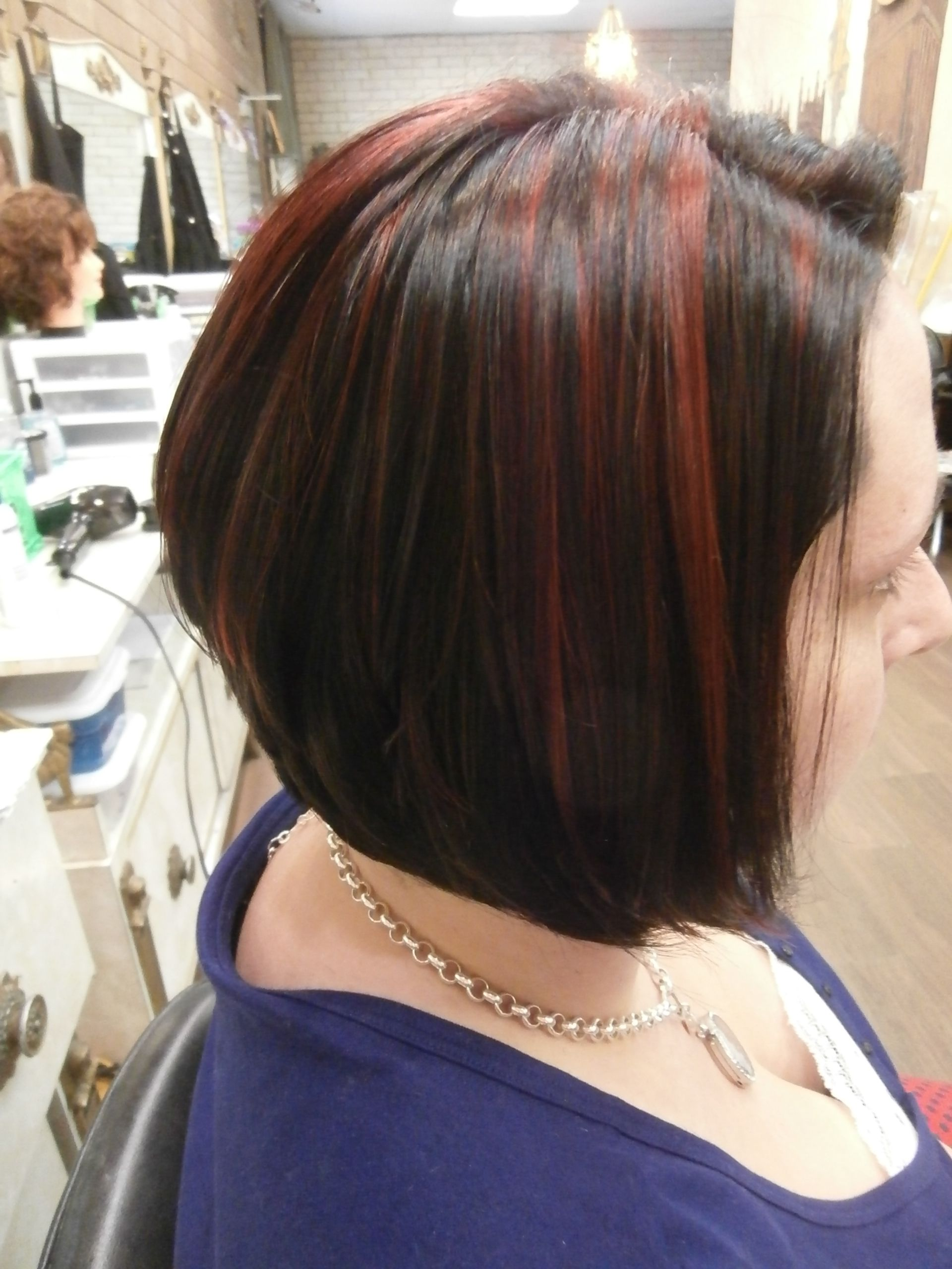 loved doing this color swing bob cut dark with red highlights