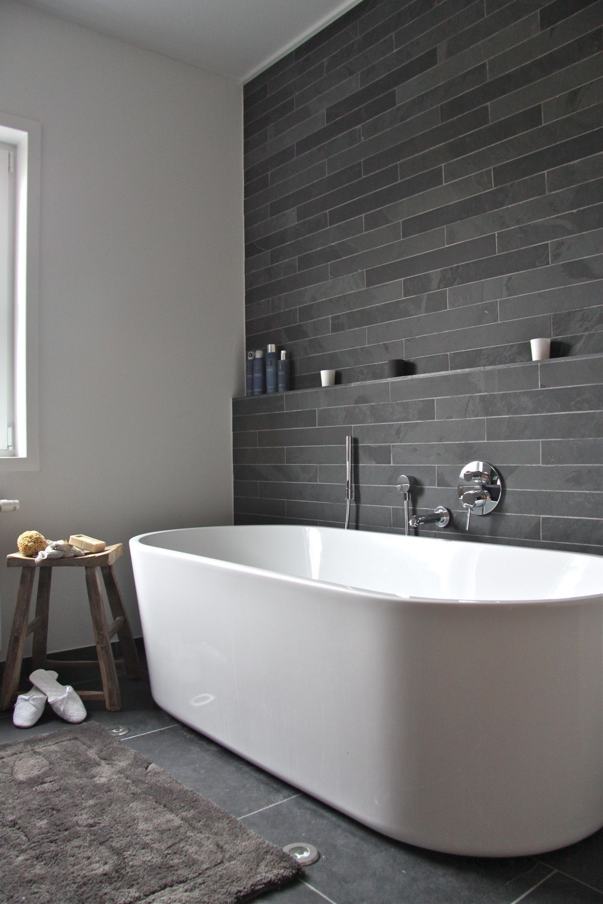 Hammam aan huis tubs walls and slate bathroom compact grey wall tile accent background paired with big white freestanding tub beside wooden bench flawless white grey bathroom decoration dailygadgetfo Gallery