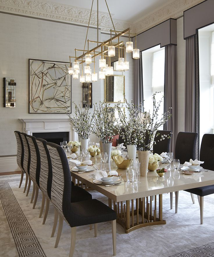 Lighting all the beautiful design elements in this dining for Beautiful dining room chandeliers