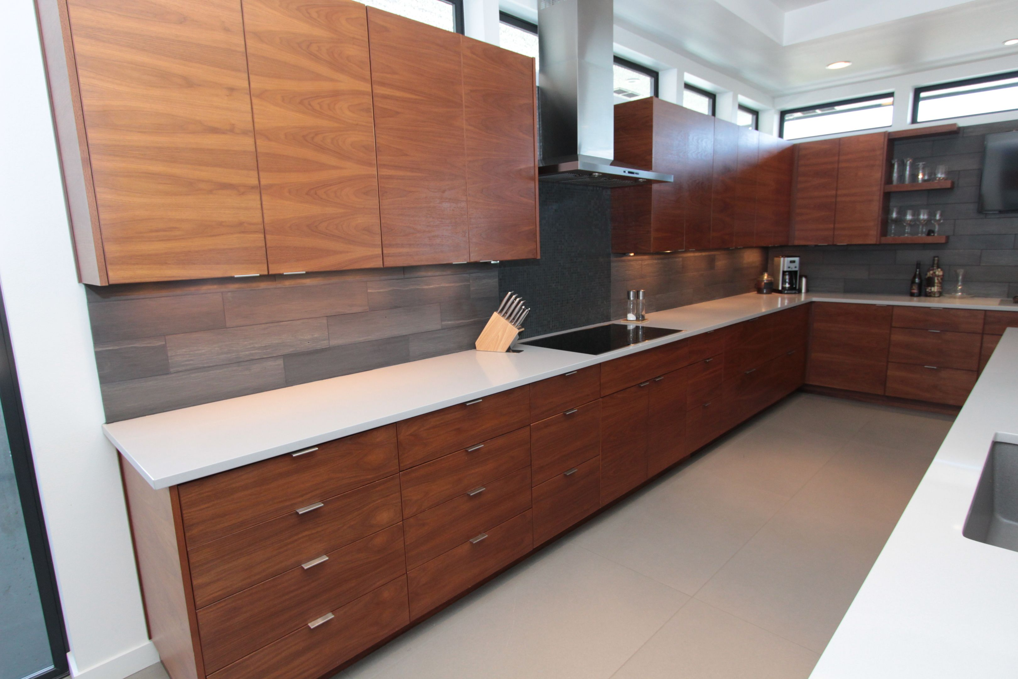 I like the grey walls with white countertop and wood cabinets ...
