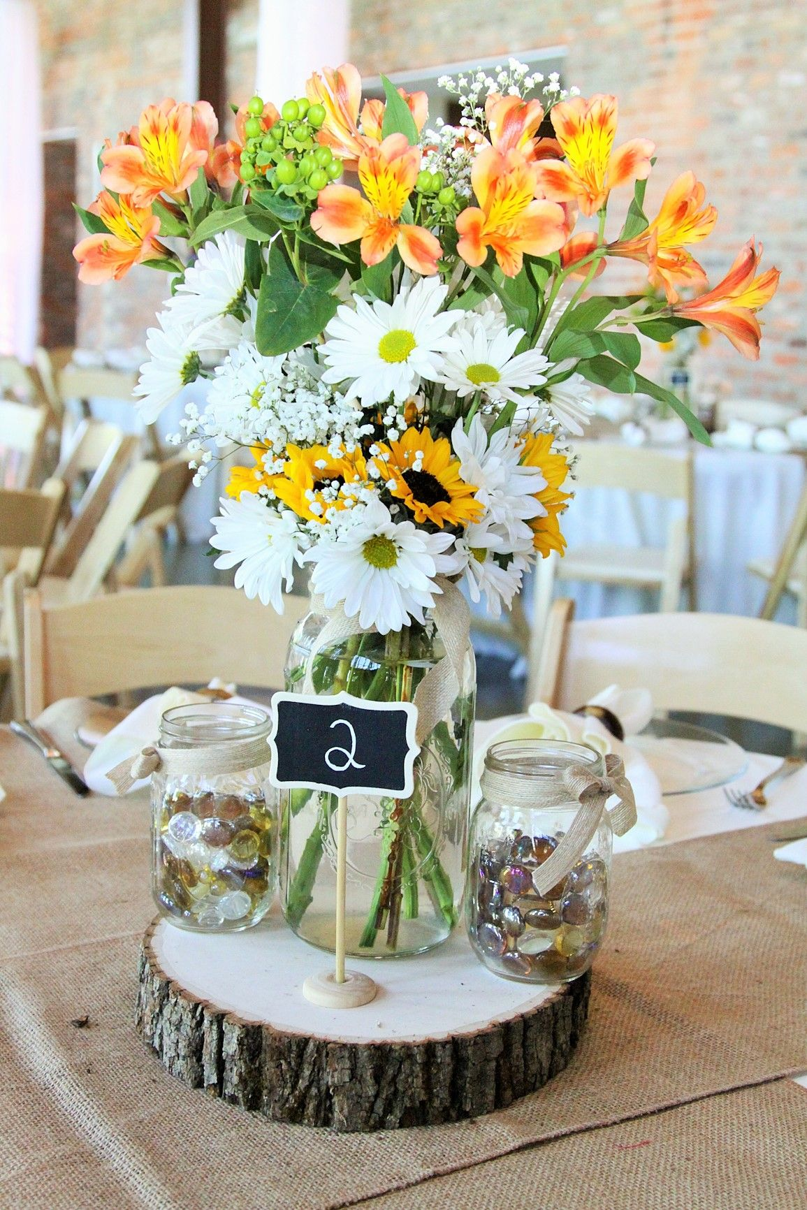 Country wedding centerpiece round wooden base and glass