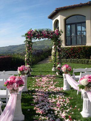 walkway idea for side of house (pillars with flowers and tulle)