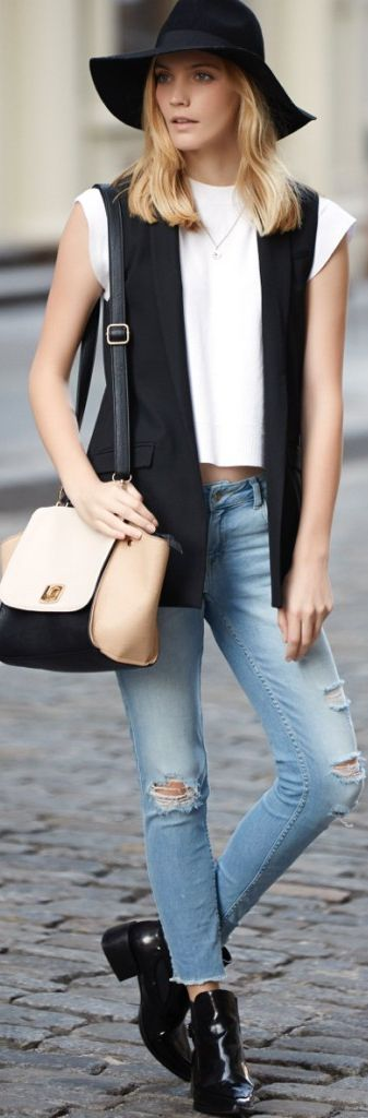 """Wow. I love it. A wonderment of high and low with a vintage feel and a cool girl vibe with each accessory. The """"I just threw these jeans on""""...Like a pair of worn in and torn Levi's, positioning themselves in contrast of the highly glossed black Zara ankle booties and this is a little bit of fashion right here. It's the vest, the shoulder bag and the rest. This is fashion for fashion lovers VOGUEgoneROGUE."""