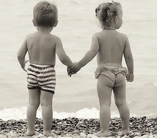 Little Kids Holding Hands In Love