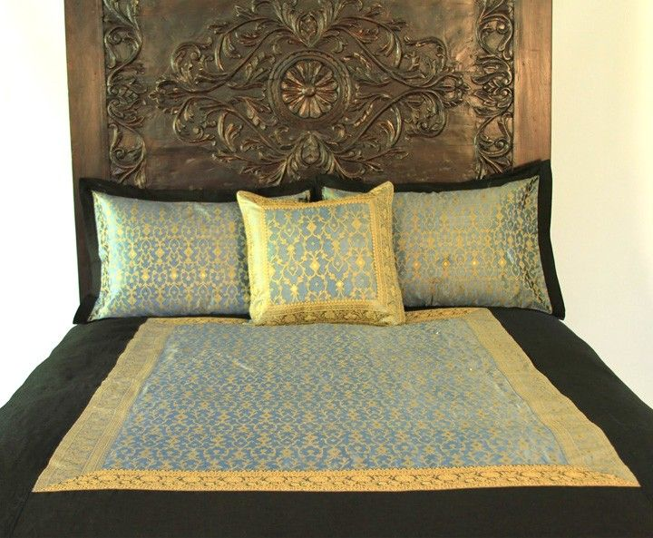 Carved Indian bed with sari bedding. I'm in love with this bed.