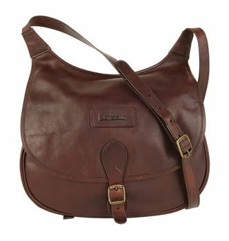 The shoulder bag has a long adjustable leather sholder strap and a ...