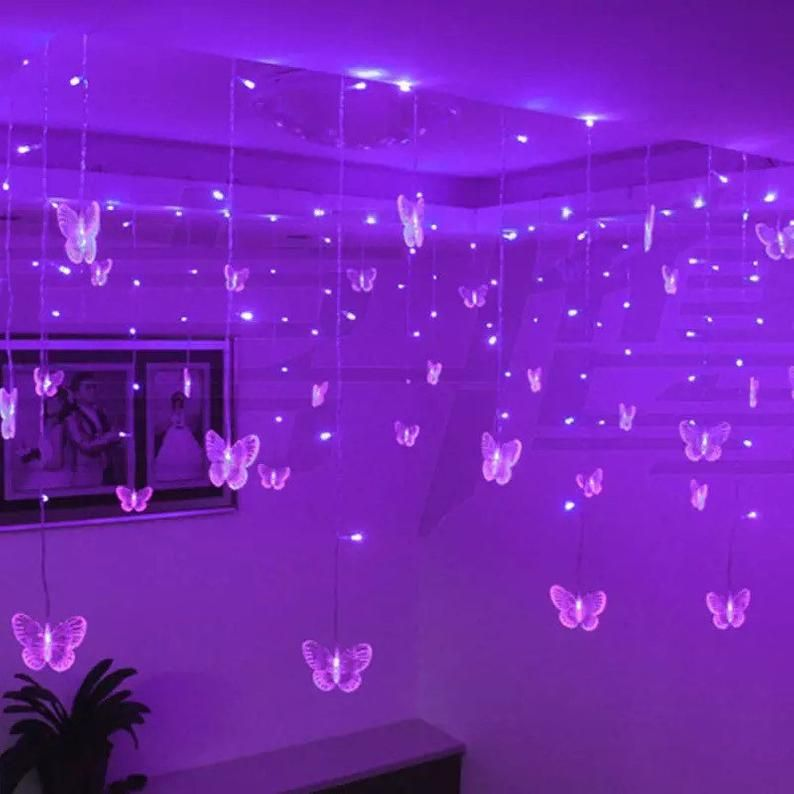 Butterfly hanging fairy lights in pink or purple