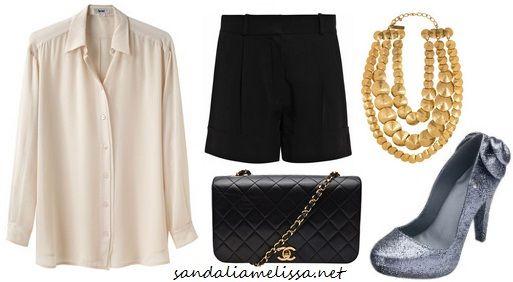 Melissa Incense glitter, com camisa em tecido fluido, bermuda de alfaiataria, maxi-colar dourado e clutch preta.