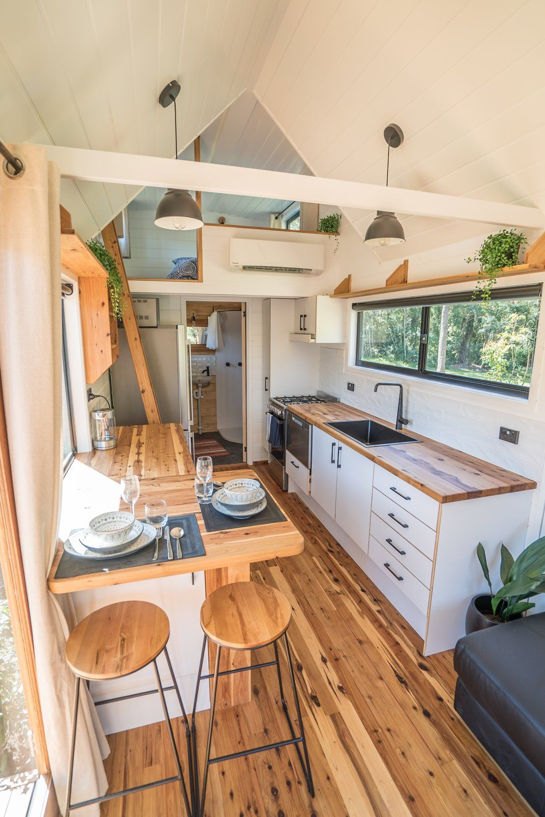 Sojourner by Häuslein Tiny House Co. With Slide-Out Living Area