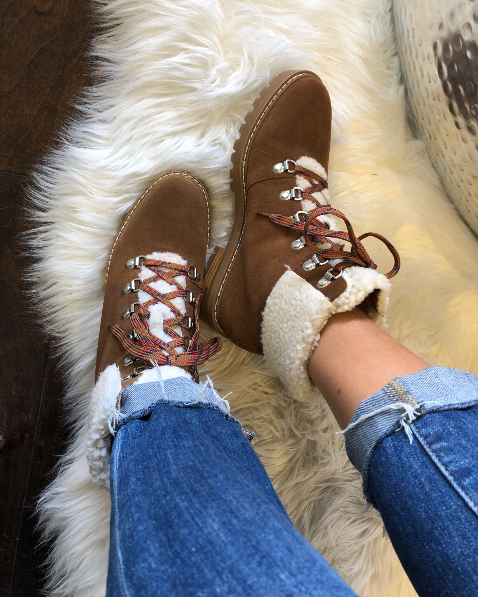 Hiking boots with shearling trim for