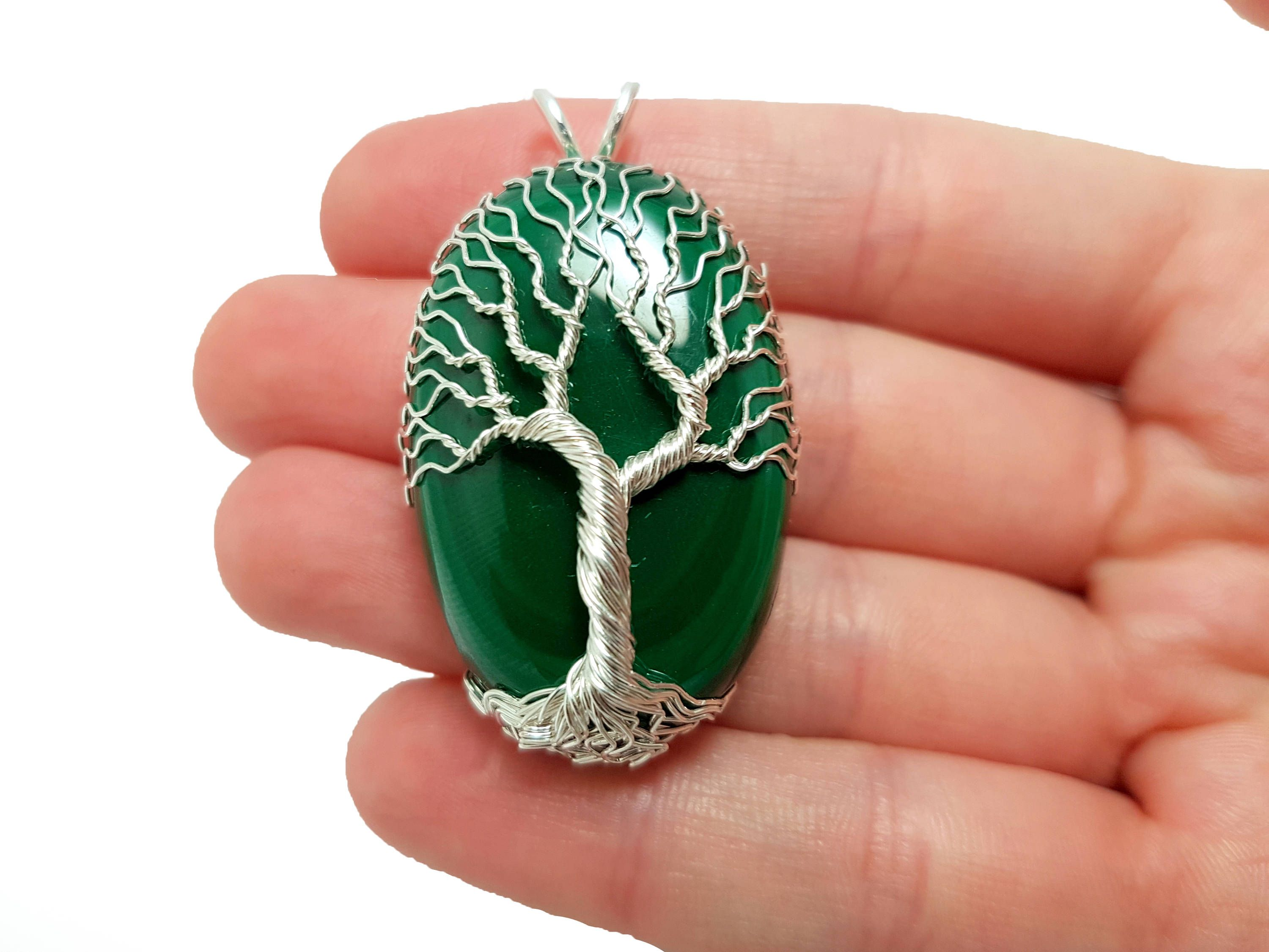 Malachite, with its green color, is a perfect setting for a tree of ...
