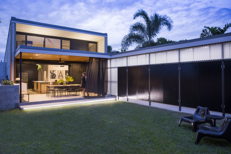 Laneway House's covered dining area flows effortlessly into a well-designed courtyard space - actually it's more like a semi-enclosed backyard. It's an affective way to blur the boundaries between indoors and outdoors.