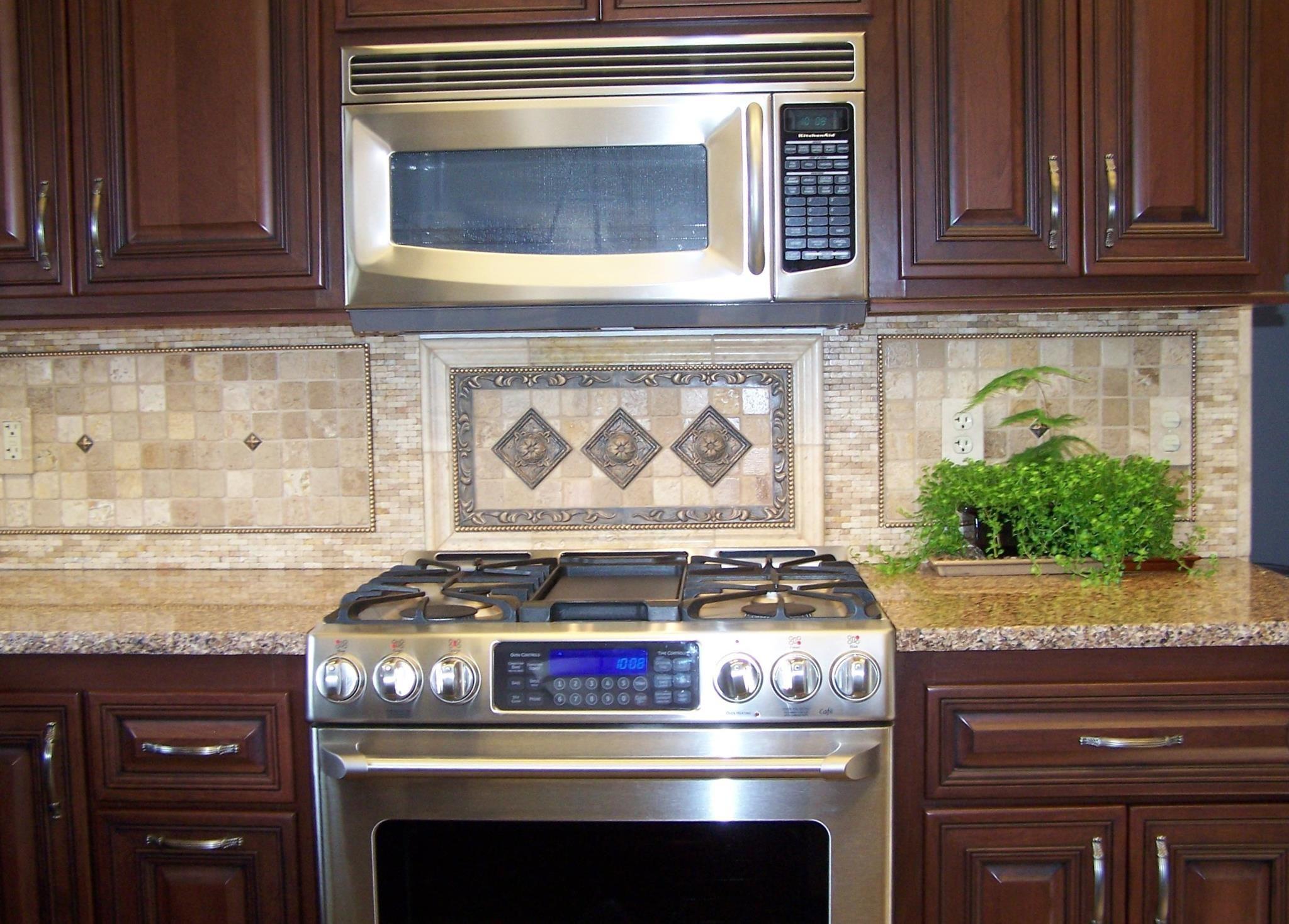 natural stone 1 2x1 2 splash decorative medallion above stove