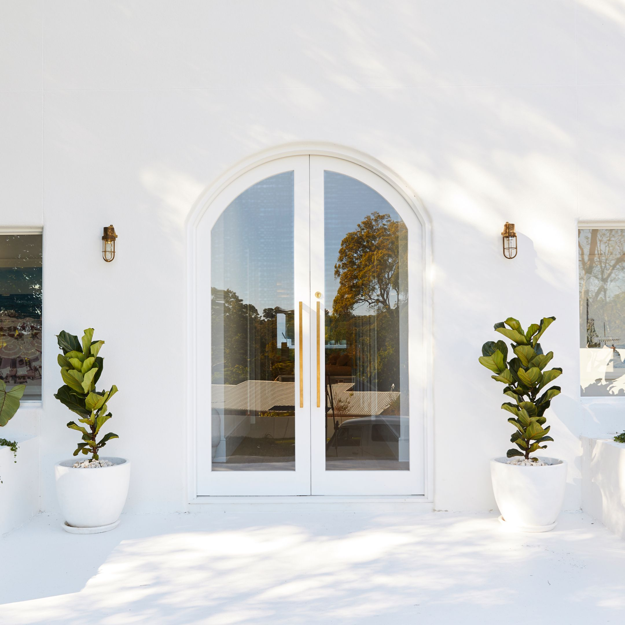 White Arched Doorways Are Located On Either Side Of The Walkway With A Bookshelf On One Side And A View Of The Lower L Japanese House Townhouse Interior House