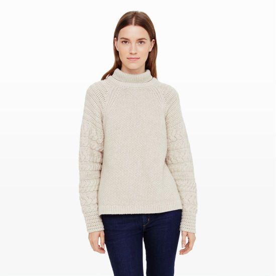 "Playing on chunky tonal texture, this sumptuous cashmere sweater is distinctive with richly cable-knit sleeves and a unique collared turtleneck. Cashmere Relaxed fit 23 ½"" in length from high point of shoulder Round collar with articulated turtleneck; variegated cable knit at sleeves; rib knit at collar and hem; hem split at side seams Dry clean Imported"