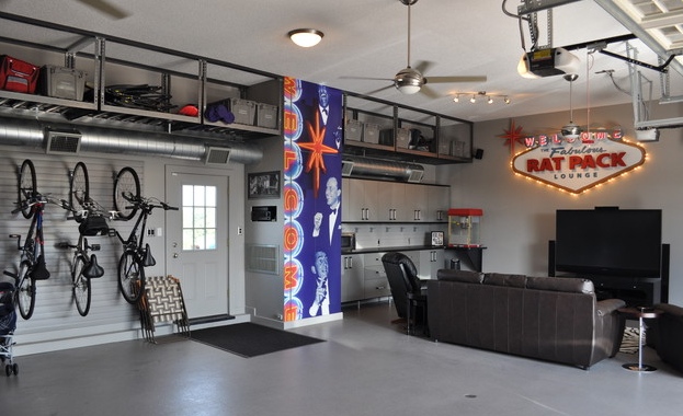 Garage Space With A Ceiling Fan Bike Rack Upper Storage And Family Hang Out Area Garage Game Rooms Man Garage Garage Remodel