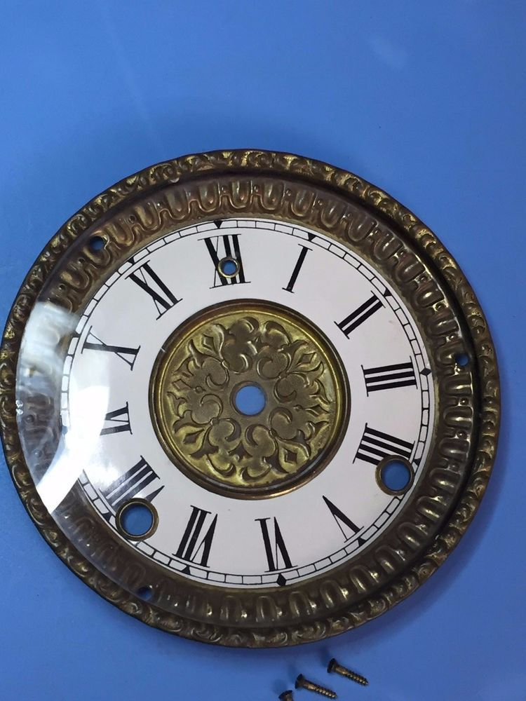 """The bezel is 5 3/4"""" and 4 15/16 across. Center of winder hole to center of winder hole measures 3 1/4"""". Center to center of winder hole measures 2"""". 
