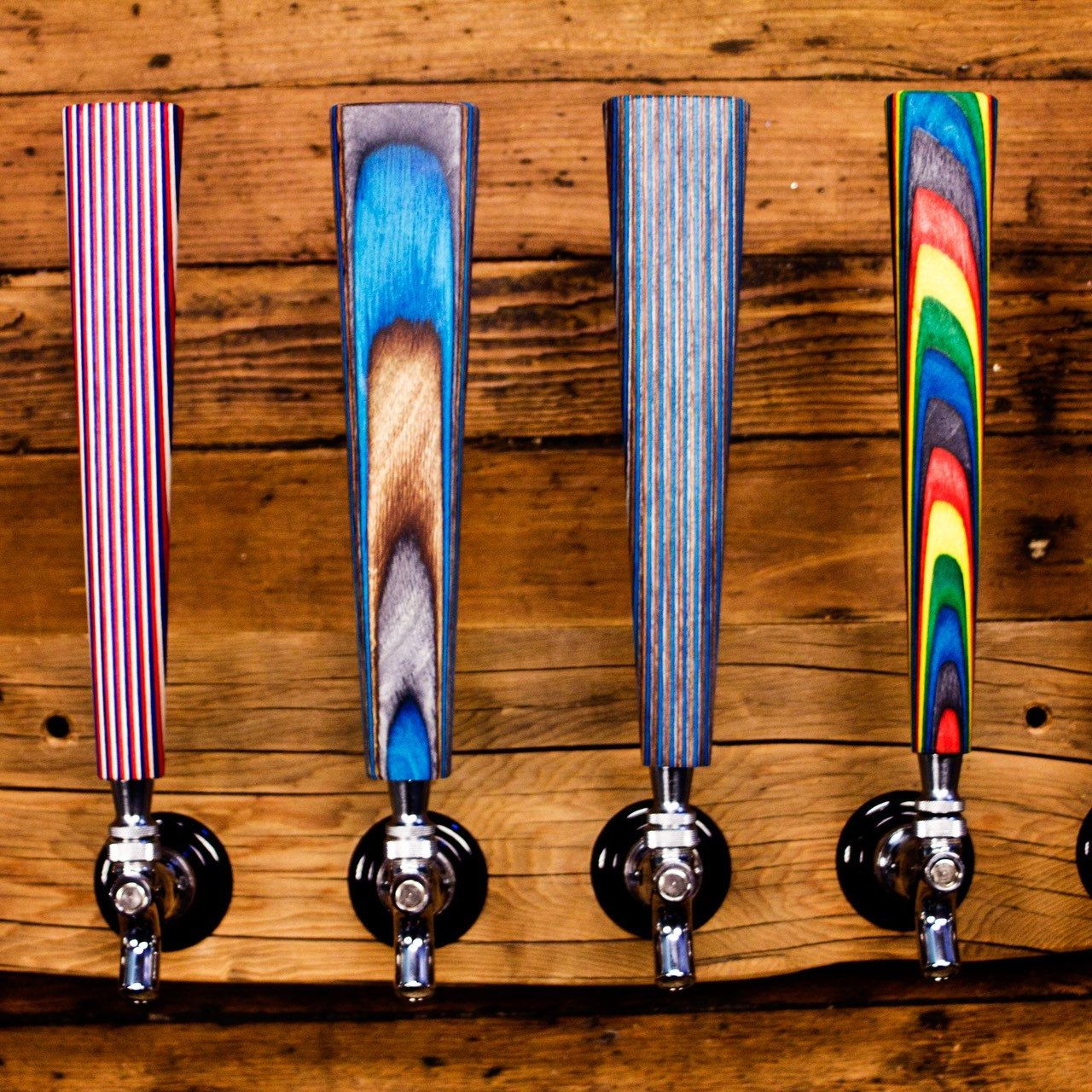 Beardedboydesign shared a new photo on beer taps wood