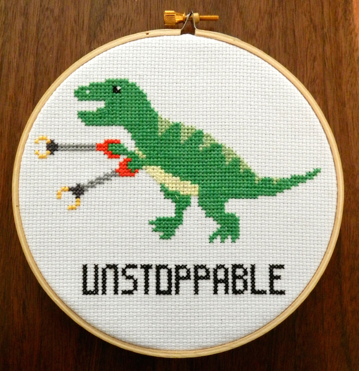 Photo of T-rex cross stitch